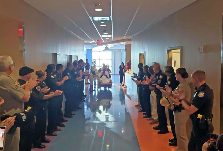Officers lined the hall to help present Jaxon with his WISH